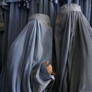 Farzana Wahidy, Conversation in a burqa shop, Kabul Afghanistan, May 2, 2007