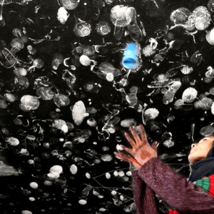 Farzana Wahidy, Making an impression. An Afghan girl throws her shoes upward to a ceiling littered with other footwear