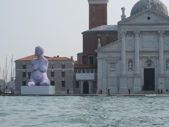 Shot of Venice with sea and marble, statue is Alison Lapper by Marc Quinn