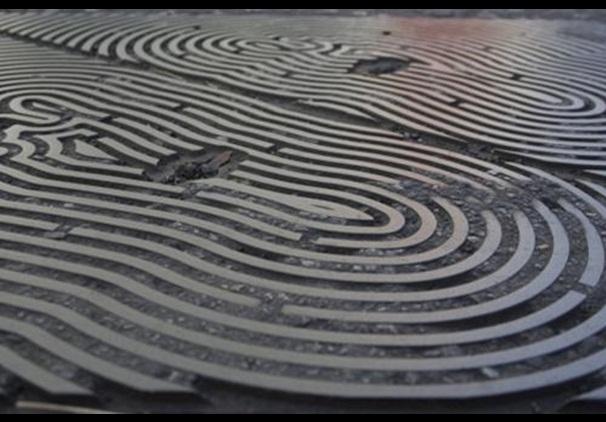 Anthony Gormley's manhole cover